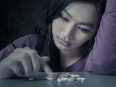 Female-Student-With-Pills