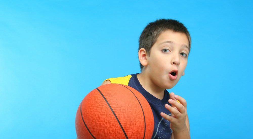 boy-playing-basketball-blue-background[1]