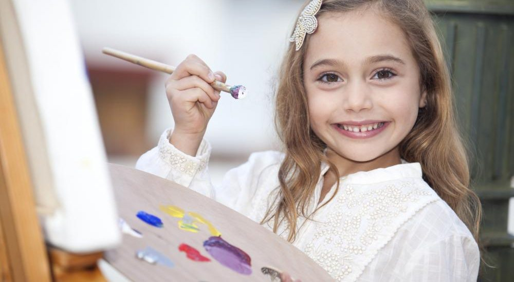 little-girl-painting-outdoors[1]