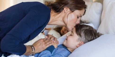 bigstock-Mother-giving-good-night-kiss--1200
