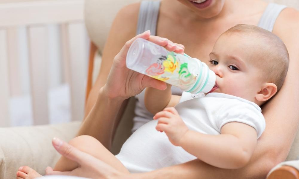 mother-feeding-baby-with-milk-bottle