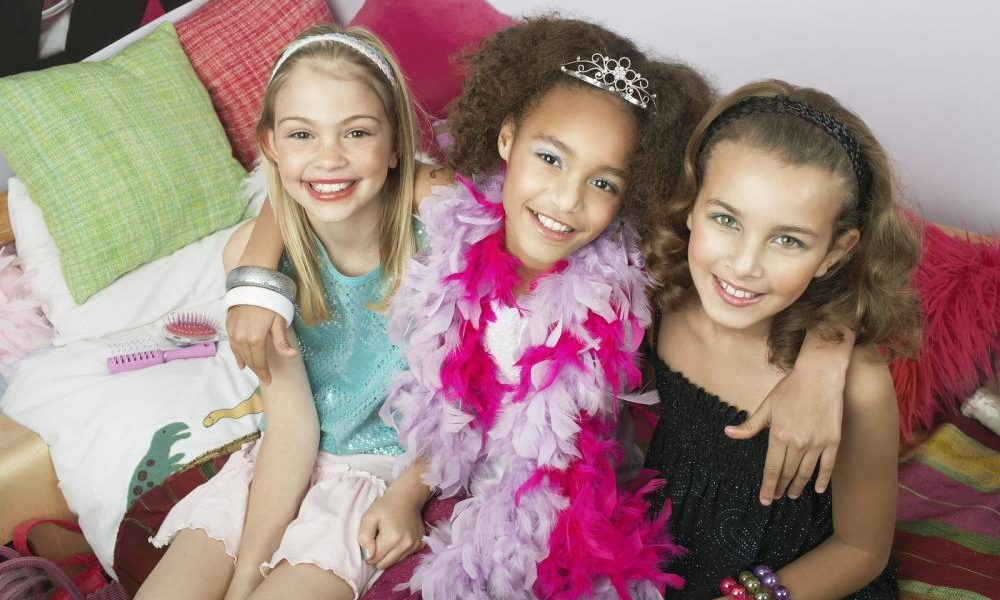 portrait-of-three-multiethnic-girls-sitting-with-arms-around-on-trendy-sofa-at-a-slumber-party[1]