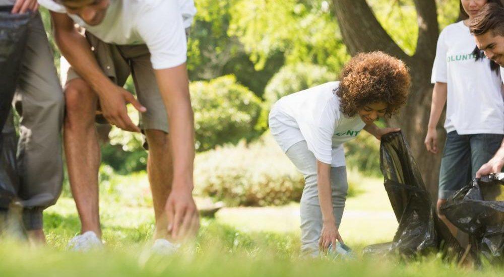 team-of-volunteers-picking-up-litter-in-park[1]