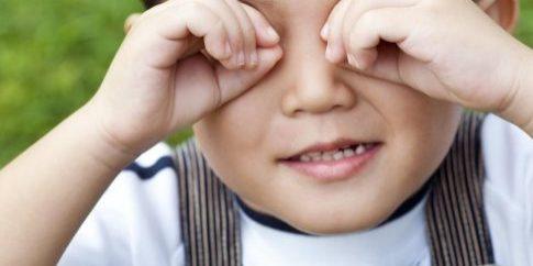 boy-covering-eyes