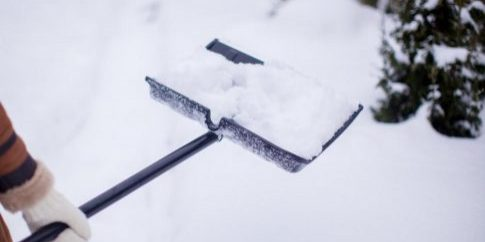close-up-of-young-womans-hands-shovelling-snow-from-path[1]